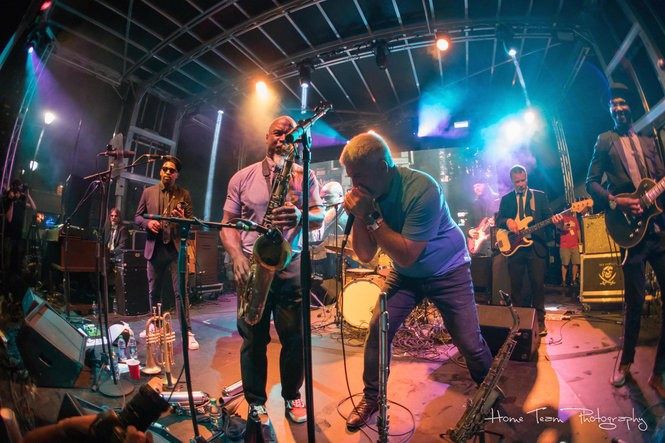 Taylor Hicks, foreground right, made a guest appearance with Karl Denson's Tiny Universe at SliceFest in Birmingham on June 3, 2017. Hicks, a country-soul artist, has been slowly revealing details for his next album. (Home Team Photography)
