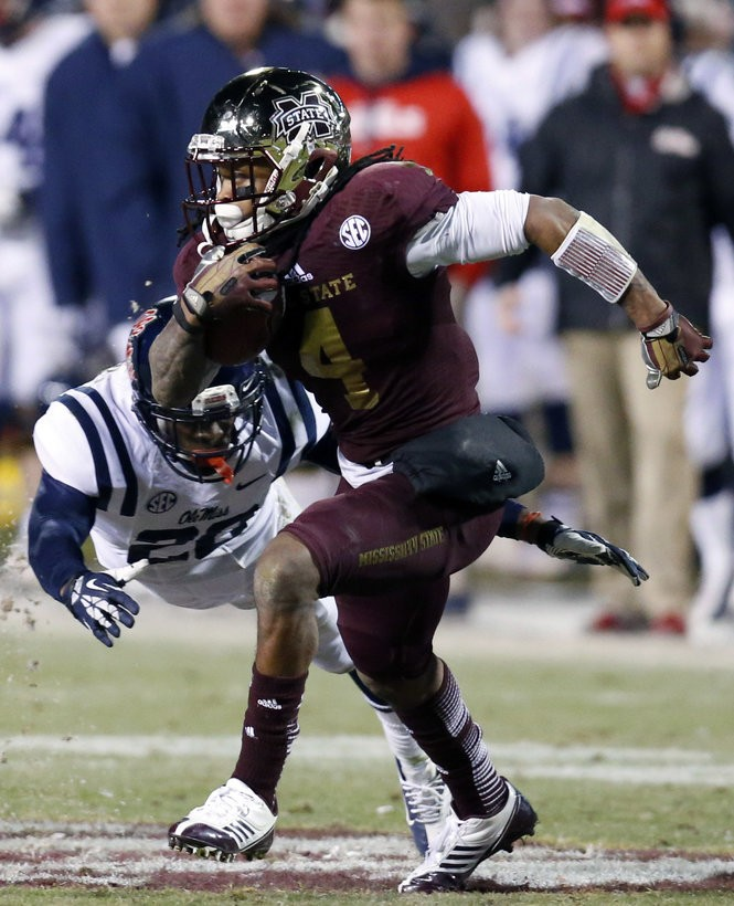 35ce8219f Mississippi State wide receiver Jameon Lewis (4) runs past Mississippi  defensive back Carlos Davis