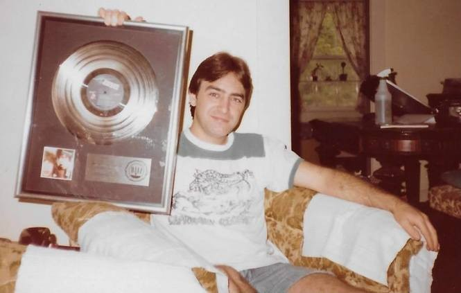 "Wayne Perkins holding the gold record he received for his work on The Rolling Stones' ""Black and Blue"" album. (Courtesy Perkins family)"