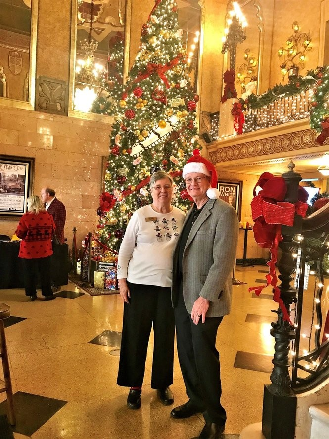Tom and Loretta Cronier, who recently celebrated their 49th wedding anniversary, pose for a picture in front of the Alabama Theatre's Christmas tree. (Bob Carlton/bcarlton@al.com)