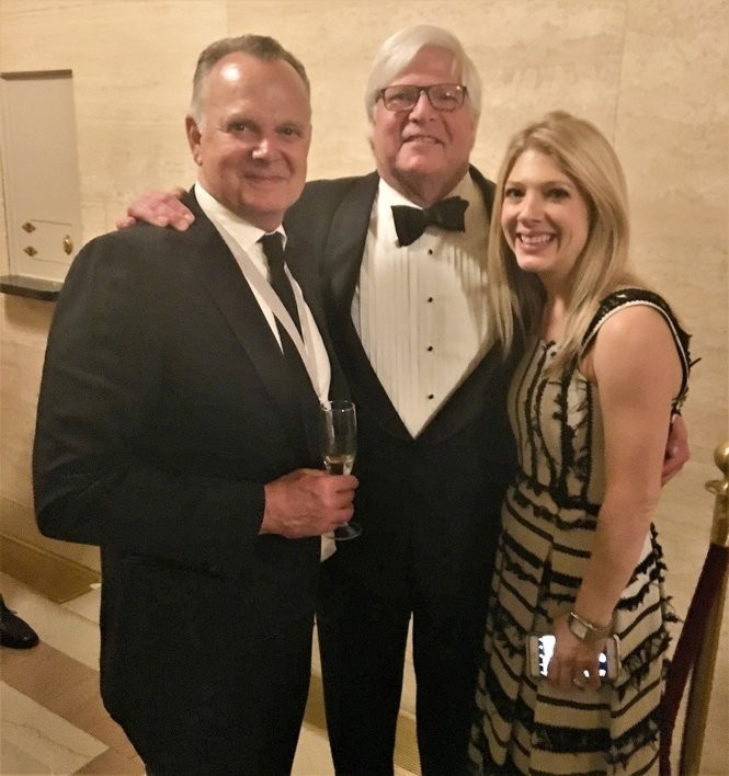 Mat Whatley, center, and his daughter Lacey Whatley Alford, right, help Frank Stitt celebrate Highlands Bar and Grill's win at the 2018 James Beard Foundation Awards in Chicago. (Bob Carlton/bcarlton@al.com)