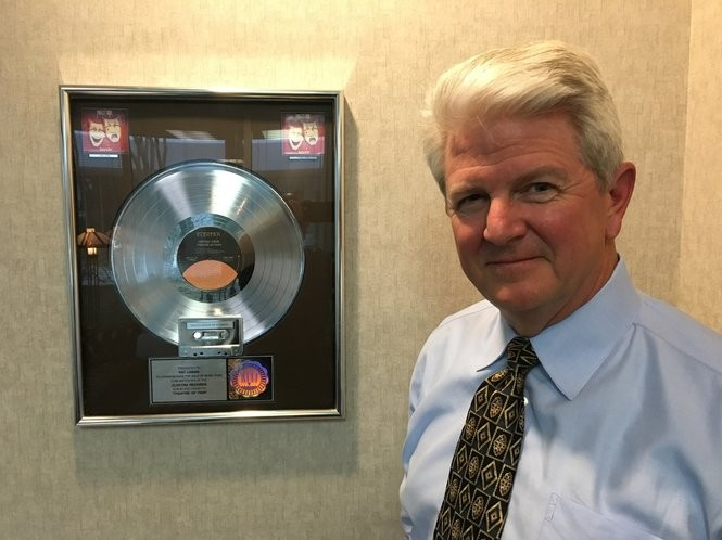 """Huntsville, Ala. attorney Patrick Lamar with a framed platinum record commemorating Motley Crue's """"Theatre of Pain"""" album he received after helping represent the band in a 1988 trial. (Matt Wake/mwake@al.com)"""