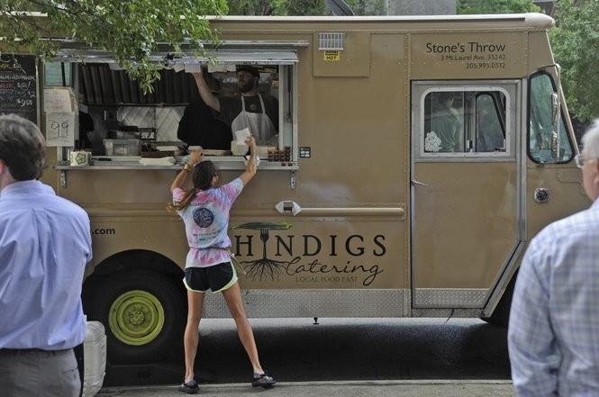 """The Shindigs Catering food truck is affectionately nicknamed """"Miss Piggy"""" because it drinks gas """"like Miss Piggy eats cupcakes,"""" Mac Russell says. (Birmingham News file/Bernard Troncale)"""