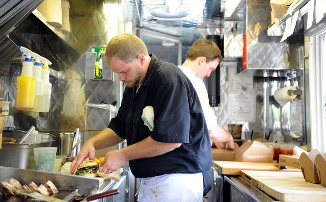 Chad Schofield, in the foreground, and Mac Russell, in the back, cranked up their Shindigs Catering food truck in 2011. (Birmingham News file/Michelle Campbell)