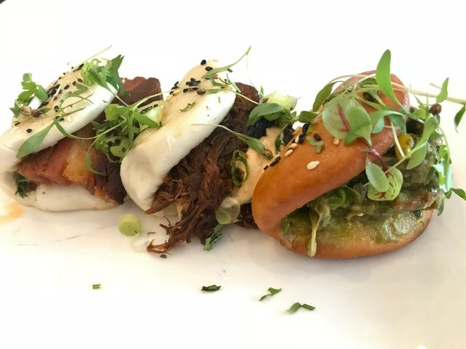 The Korean steamed buns are one of Mac Russell's signature dishes on the menus of both the Shindigs Catering food truck and his Whistling Table restaurant. (Bob Carlton/bcarlton@al.com)