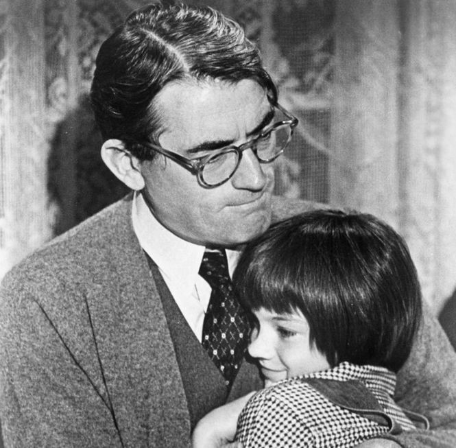 """Gregory Peck, who played the virtuous Atticus Finch in """"To Kill a Mockingbird,"""" was like a second father to Mary Badham, who lovingly called him """"Atticus."""" (Universal Pictures photo)"""