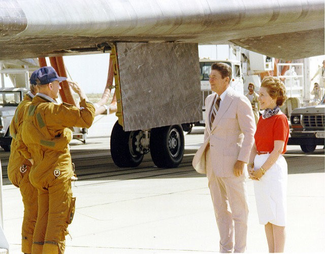 Columbia Space Shuttle astronauts Commander Ken Mattingly, foreground, and Pilot Henry Hartsfield salute President Ronald Reagan and his wife, Nancy, upon safely landing the Space Shuttle Columbia at Edwards Air Force Base on July 4, 1982 after a week in orbit.