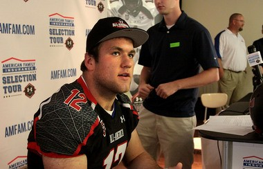 Grant Hill, offensive lineman for Huntsville High School, wears his Under Armour All-American Game jersey while talking to the press after his presentation Friday afternoon.