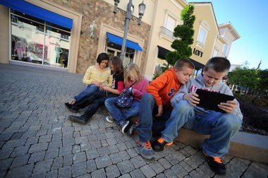 Left to right: Alexa Bryan, 9, Kinsley Bryan, 7, Macey Davis, 7, Gerry Wayne Davis, 9, and John Bryan, 12, Pulaski, Tenn., take a break from shopping with their parents at Bridge Street Tuesday afternoon. (file photo by Sarah Cole/al.com)