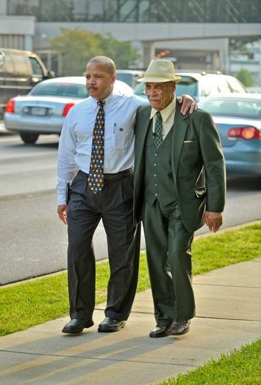 Sonnie Hereford IV and his father Dr. Sonnie Hereford recreate their Sept. 9, 1963 walk along Governors Drive on the 50th anniversary of the event. (Bob Gathany/bgathany@al.com)
