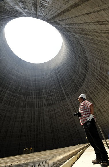 Damien Power, with TVA, looks up inside one of the two 500-foot cooling towers at the partially finished reactor at TVA's Bellefonte Nuclear Plant site Thursday, June 2, 2011 in Hollywood, Ala. (The Huntsville Times/Eric Schultz)