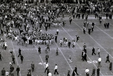 Fans flood the field to congratulate the Alabama football team after their 34-0 victory over Auburn in 1961. (File Photo / The Birmingham News)