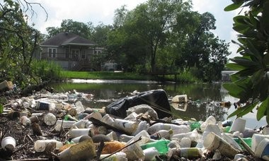Islands of trash pile up in Dog River after rains. A new litter trap installed by the city of Mobile failed to stem the tide when confronted by its first test this week. (Ben Raines/braines@al.com)