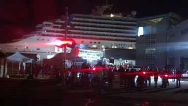 The Carnival Triumph arrives under tow at the Alabama Cruise Terminal in Mobile, Ala., on Feb. 14, 2013, after spending several days adrift in the Gulf of Mexico. (Kelli Dugan/kdugan@al.com)