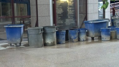 Mobile Government Plaza employees on Thursday, May 2, 2013, set up trash cans to catch water leaking from the roof over the atrium of the building, but several puddles formed on the floor anyway. Leaks have been a chronic problem in the 18-year-old building. (Brendan Kirby/bkirby@al.com)