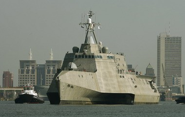 The littoral combat ship Independence, manufactured at Austal USA's shipyard in Mobile, heads south down the Mobile River with the skyline in the background on July 2, 2009, in Mobile, Ala., for four days of sea trials in the Gulf of Mexico.