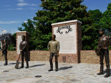 Bronze statues of the group Alabama were erected in Fort Payne, the hometown of three of the band's members. (Contributed by Encyclopedia of Alabama)