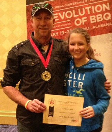 Brian Potter and his daughter, Annabelle, show the Award of Excellence at National Barbecue Association Conference in Mobile. (Courtesy of Shannon Potter)
