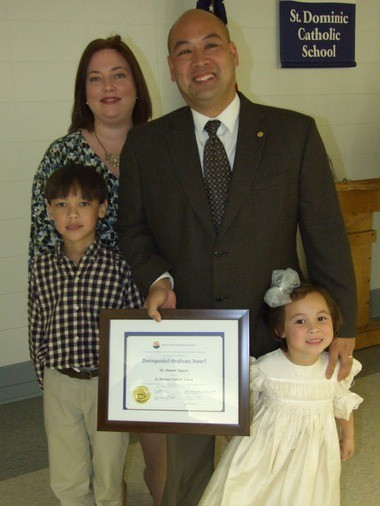 The National Catholic Educational Association has named Danner Nguyen a 2013 NCEA Catholic Elementary School Distinguished Graduate. Danner, a teacher at St. Dominic Catholic School, is shown with his children, Stone, left, and McKenna, and his wife, Christina. (Courtesy of Michele M Grimes)