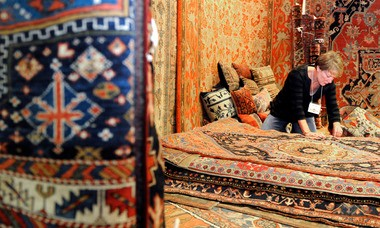 Dell Kelly, of Dana Kelly Oriental Rugs, organizes items as vendors set up for Antiques at the Gardens: Heirlooms in Bloom at the Birmingham Botanical Gardens on Wednesday, Sept. 30, 2009, in Birmingham, Ala. (The Birmingham News / Michelle Williams)