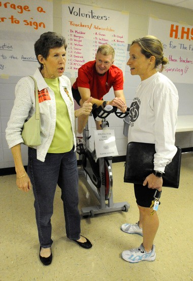 Homewood High School hosted the first Bike for Bagwell event in 2009 to benefit the American Cancer Society. They donated the proceeds in honor of Lynda Bagwell, a long time Homewood High teacher (pictured here) who lost her battle to cancer a few months later. (From left to right) Lynda Bagwell chats with David Jones (football coach and driver ed teacher) and Nivada Spurlock (HCS wellness coordinator) who worked to put the event together. (The Birmingham News/Beverly Taylor)