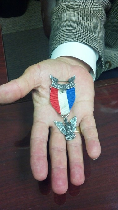 Bill Bright shows his Eagle Scout badge, which he plans to return in protest. (Greg Garrison/ggarrison@al.com)