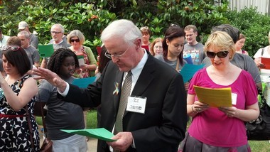 The Rev. Oliver Clark, a retired minister who serves on the staff at Canterbury United Methodist Church, leads a prayer for acceptance of gays and lesbians during a break at the North Alabama Conference of the United Methodist Church, with the Rev. Emily Freeman Penfield, right, pastor of Woodlawn United Methodist Church. (Photo by Greg Garrison/ggarrison@al.com)
