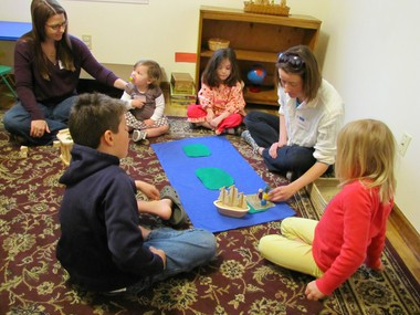 """Using Montessori-style teaching method of Godly Play, """"Danielle Chouinare focuses on the story of an early Quaker missionary she tells a circle of children at the Huntsville Area Friends Meeting in Huntsville, Ala., on April 21, 2013. (Kay Campbell / KCampbell@al.com)"""