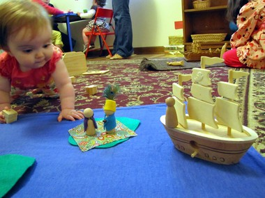 Iris Henning, 9 months, investigates the figures used to tell the story of Mary Fisher, an early Quaker missionary, in the children's room of the Huntsville Area Friends Meeting in Huntsville, Ala., on April 21, 2013. (Kay Campbell / KCampbell@al.com)