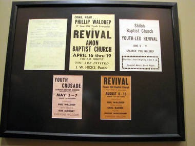 A framed collection of early copied and mimeographed flyers for revivals Phil Waldrep preached as a teen evangelist hangs in the Phil Waldrep Ministries office in Decatur, Ala. (Kay Campbell / KCampbell@al.com)