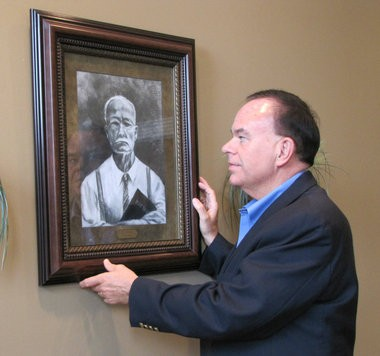 A portrait of Phil Waldrep's great-grandfather, Lee Waldrep, hangs in Waldrep's office at the Phil Waldrep Ministries building in Decatur, Ala. Waldrep says that the picture reminds him daily of the responsibility he owes to those who have mentored him during his ministry. (Kay Campbell / KCampbell@al.com)