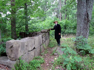 The Rev. Myron Mooney, pastor of the Free Presbyterian Church in Trinity, Ala., pauses by a stone wall in the cemetery where his great-great grandfather, a veteran of the Civil War, is buried. June 27, 2013. (Kay Campbell / KCampbell@al.com)