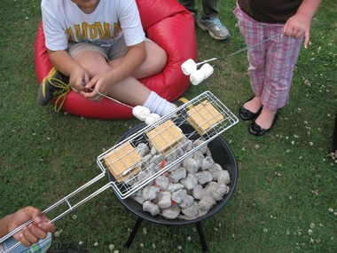 Children enjoyed an evening of making s'mores and storytelling during one of Hobson City Library's summer evening programs. (Audrey Ross/Living Democracy Community Reporter)
