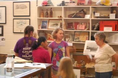 Deanna McKinney, Lynda Pedro and Naomi Cummings, from left, explore the Collinsville History Museum with Rebecca Clayton. (Nathan Simone/Living Democracy Community Reporter)