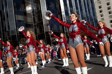 Cheerleaders from the Homewood High School Patriot Band, in Alabama, march and cheer during Macy's Thanksgiving Day Parade, Thursday, Nov. 24, 2011, in New York. (AP Photo/John Minchillo)