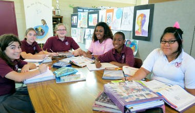 The faces of students at Holy Family Catholic School in Huntsville, Ala., reflect the ethnic diversity of the city -- and also reflect, say students, the face of God. Seventh grade students studying science together on Tuesday, Sept. 3, 2013, are, from left, Juliana amato, Rachel Gullatt, Maddie Aquila, Faith Stewart, Michael Weston and Leslie Hernandez. (Kay Campbell / KCampbell@AL.com)