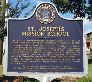 An historic marker notes the place that Holy Family Catholic School, 2300 Beasley Ave. in Huntsville, Ala., then St. Joseph's Catholic School, played in the history of Alabama when it opened its doors without incident to students both black and white on Sept. 3, 1963, nine days before Huntsville public schools would grudgingly allow black students into white schools. (Kay Campbell / KCampbell@AL.com)