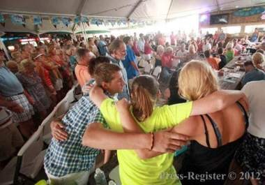 Congregants pray at Worship on the Water, held at the Flora-Bama, on the Alabama-Florida line, in August 2012. (AL.com)