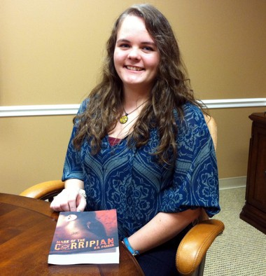 """Bethany Parker, 19, of the Indian Springs area in Shelby County, is getting ready to release her debut novel, """"Mark of the Corripian,"""" on Oklahoma-based Tate Publishing on Feb. 25, 2014. She will be available to sign pre-release copies of her book at the North Shelby Library from 2 to 3 p.m. on Sunday, Jan. 12, 2014. (Martin J. Reed / mreed@al.com)"""