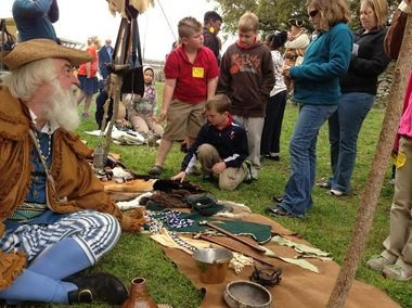 Re-enactor David Bayne shows artifacts to visitors at Colonial Day at Fort Conde. (Courtesy of the History Museum of Mobile)
