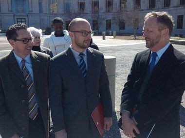 Paul Hard, right, talks with Southern Poverty Law Center attorneys David Dinielli, left, and Sam Wolfe outside the federal courthouse in Montgomery, Ala., on Feb. 13, 2014. (Mike Cason/mcason@al.com)