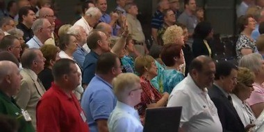 """Messengers to the Southern Baptist Convention sing """"Amazing Grace"""" during the 2014 Annual Meeting June 10, 2014, in Baltimore, Md. (Christian Post)"""