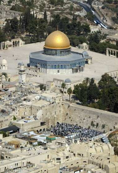 This is an aerial view of the golden Dome of the Rock Mosque at the Al Aqsa Mosque compound, known by the Jews as the Temple Mount, top, as Jewish worshipers pray at the Western Wall, in this Oct 4 2004 photo. Huntsville Imam Ragab Abdelmoneim and Rabbi Elizabeth Bahar shared prayers with each other's congregations on July 11, 2014, as a gesture of peace. (AP Photo/Oded Balilty)
