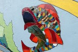 Mural features colorful fish made of glass pieces. (Jelani Moore/AU Living Democracy)