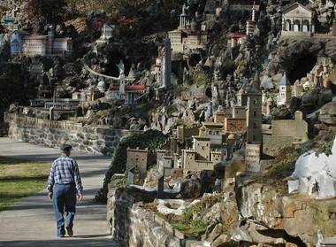 Stonemason Leo Schwaiger walks through Ave Maria Grotto. (File/The Birmingham News)