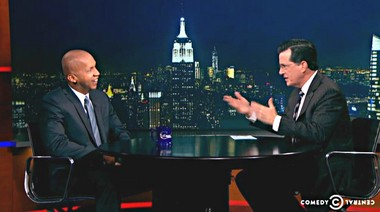 Bryan Stevenson, left, founder and director of the Montgomery-based Equal Justice Initiative who will speak in Huntsville, Ala., on Sunday, Nov. 2, 2014, talks with Stephen Colbert during the Dec. 4, 2013, The Colbert Report. (TheColbertReport.cc.com)