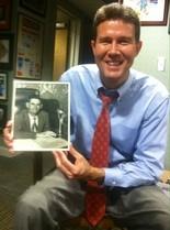 John Merrill holding a picture of Pelham Jones Merrill, a role model and the namesake of his son, Pelham Brooks Merrill.