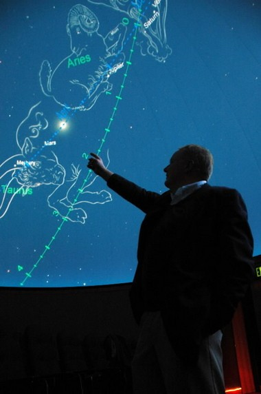 A Notre Dame astrophysicist points at a computer-generated demonstration of the night sky of April 17, 6 B.C. in the Digital Visiualization Theater at the University of Notre Dame in South Bend, Ind., in 2007. (AP Photo/Joe Raymond)