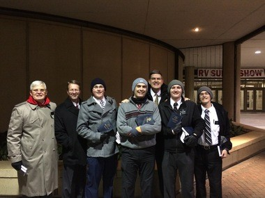 Braving freezing temperatures at times, teams of Mormon missionaries gathered in Birmingham outside the BJCC to distribute free copies of the Book of Mormon to people coming out of performances of the musical comedy 'The Book of Mormon.' (Courtesy LDS Church)