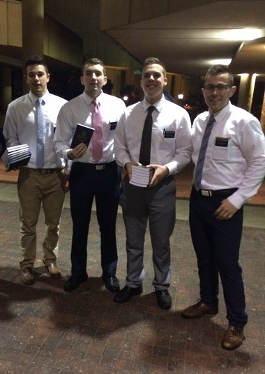 Missionaries from the Church of Jesus Christ of Latter-day Saints hold copies of the Book of Mormon to be distributed in Birmingham, Ala., to theater-goers leaving a showing of the musical comedy 'The Book of Mormon.' (Courtesy LDS Church)